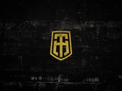 TH letter-mark shield concept