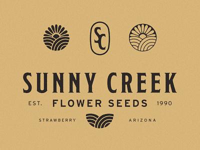 Sunny Creek Branding flower logo farm field sun flower flower seeds flower logo design logo brand identity branding heirloom seeds heirloom seeds