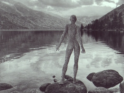 One with nature s beauty wire woman sculpture wire statue water standing sculpture outdoors nature. monochrome lake female