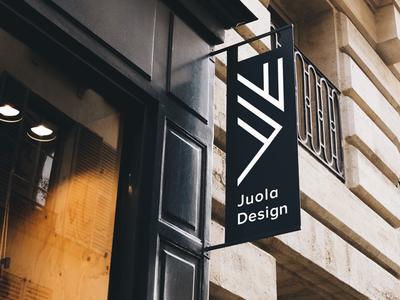Portrait version of the Juola Design logo, negative color.