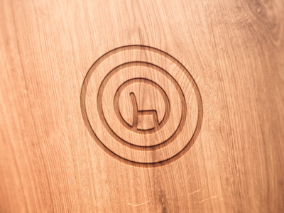 Engraved Symbol of a Chair Maker on a Wooden Chair engraved symbol chair maker wood chair logo
