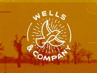 Wells & Company logo