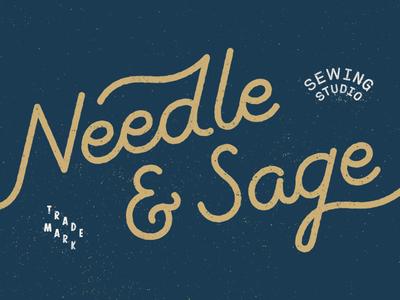 Needle & Sage gold ampersand logo script lettering