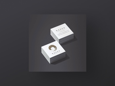Gold logo on square minimalist business cards