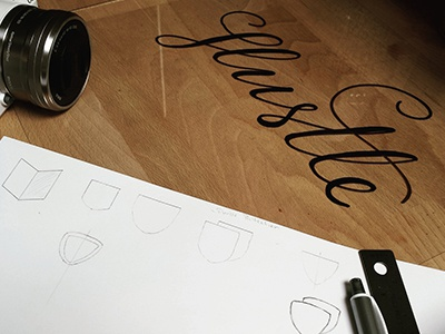 Hustle lettering logo sketches