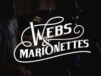 Webs & Marionettes Logo