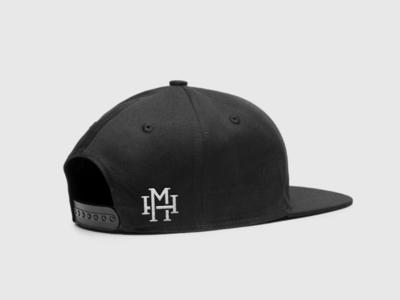 M H cap