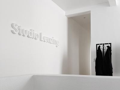 Studio Logo White on White white on white wall logo