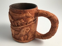 Wood carved animals mug