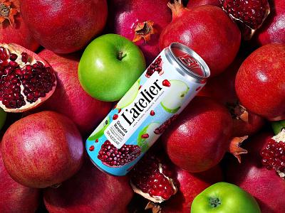 L'ATELIER — CARBONATED BEVERAGE can apples pomegranates fruit carbonated drink soda refreshing drink soft drink juice drink label brand logo trademark packaging design packaging design branding
