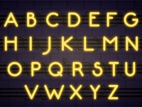 Alphabet neon sign with yellow letters