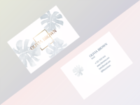 Business cards with a monstera leaf in trendy colors.