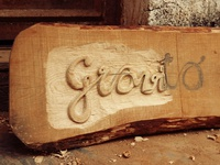 Gravito sign wood carving
