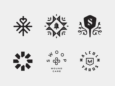 LogoLounge 12 badge m cross swoop circle burst sprout peel monogram s quilt leaves leaf bell snow snowflake heart logomark mark logo