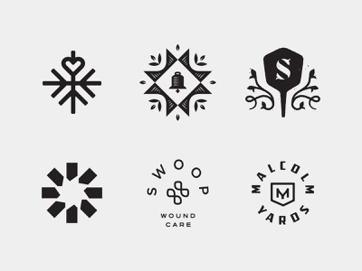LogoLounge 12 badge m cross swoop circle burst sprout peel monogram s quilt leaves leaf bell snow snowflake heart logomark mark logo