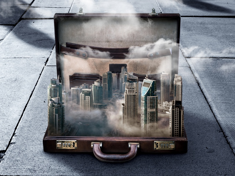Living out of a briefcase 💼 surrealism surreal hyperreal hyperrealism hyper real realism image manipulation clouds weather skyline city briefcase travel design collage manipulation photoshop