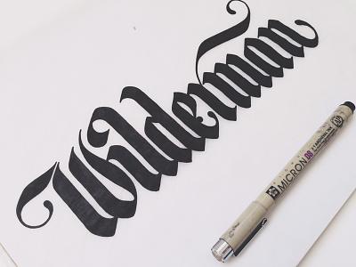 Wilderman Logo gothic type lettering design logo hand drawn