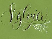 2-C inked Monogram with Flourish (Sylvia)