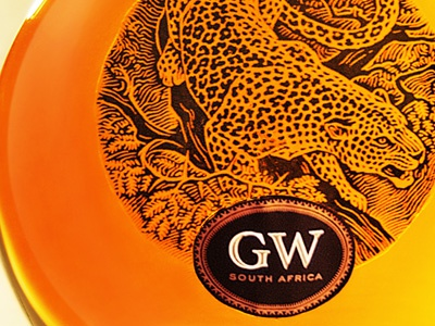 GW Brandy Packaging africa the famous frouws simon frouws bottle logo lettering handmade vintage typography type label brandy wine wine label design wine bottle wine label leopard lion lynx cheetah woodcut south africa thorn saverglass