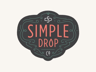 Simple Drop Co. frilly salmon black badge crest drop essential oils simple drop simple drop co.