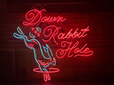 Down the Rabbit Hole neon lettering script hole rabbit signage neon