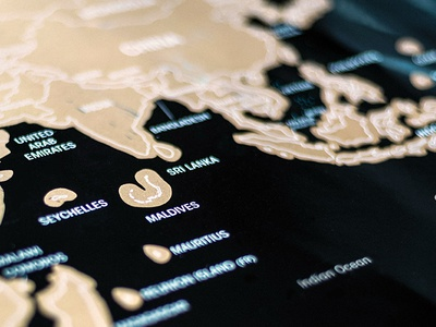 A printed scratch map prototype for a Cork Meets World project font countries colour wine travel world foil gold poster map print design