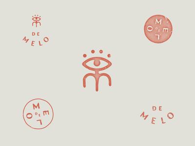 De Melo flower stamp logo