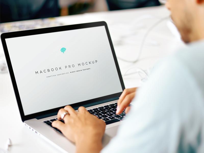 Free MacBook Mockup PSD mac hands branding psd agency freebie photoshop photorealistic mockup apple macbook free