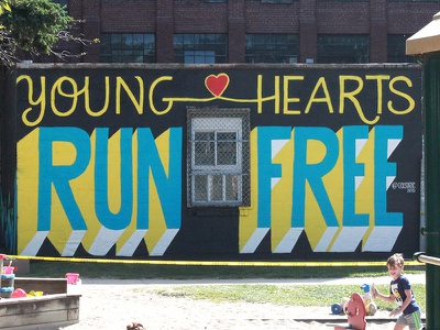 Young Hearts Run Free type lettering spray paint mural