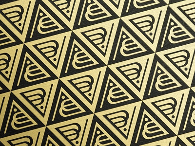 B. Valkyrie Pattern logos redesign art deco metallic gold foil gold triangle monogram pattern rebrand branding logo