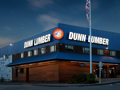 Dunn Lumber Flagship Store stars light backlit sky night signage sign mascot logo store exterior exterior design