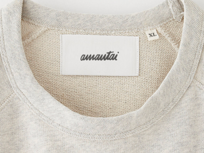 AMANTAI Clothing tag.
