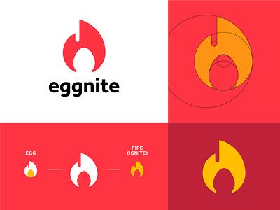 Eggnite v2 yellow red ignition flame ignite egg fire simple logo grid logo minimalist logo logomark logo design logo brand brand logo brand identity