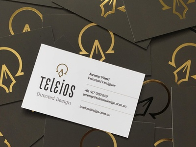 Teleios Design Business Card gold foil pen omega alpha business card stationery symbolism logo branding