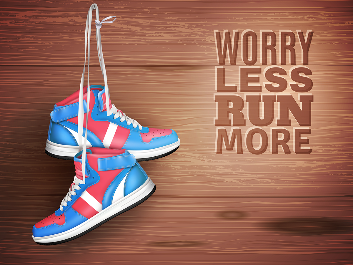 Pair of leather sports shoes on wood background Free Vector
