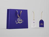 Mojgan Meibodi Shopping Bag And Tag
