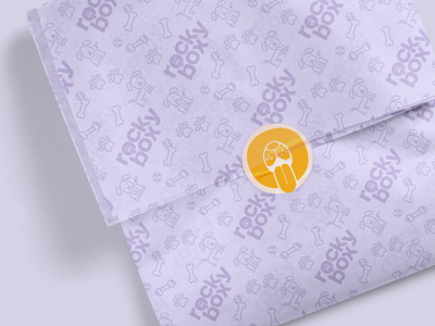Branded wrapping paper sticker pattern service pet dog logo branding and identity brand identity most studios most rockybox dog branded branding wrapping paper wrapp