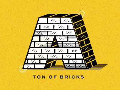 A Ton of Bricks gold ton 14k yellow drop cap brick texture atlanta orange