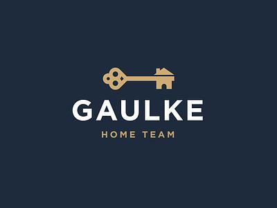 Gaulke Home Team unlock gold logo real estate key house