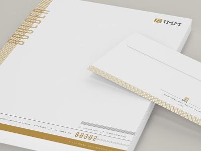 IMM Stationary letterhead branding identity envelope stationary gold