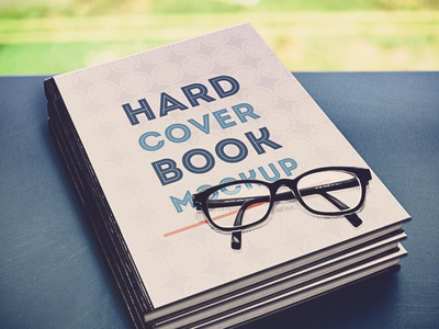 Hardcover Book Mockup  book photo mockup psd bookcover glasses grass table pattern books