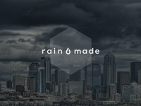 Rainmade logo on desktop wallpaper