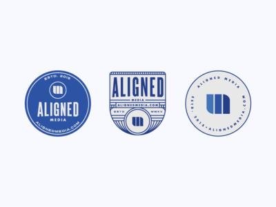Aligned Media logo badges