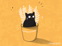 Potted cat and plant