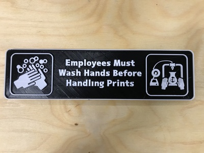 Bathroom sign created for Tangible Creative