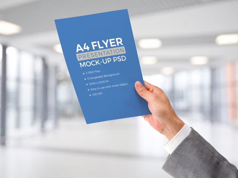 Free A4 Paper In Male Hand Mockup Psd By Zee Que Designbolts On