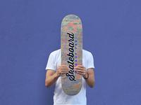Free Man Holding Skateboard Mockup PSD