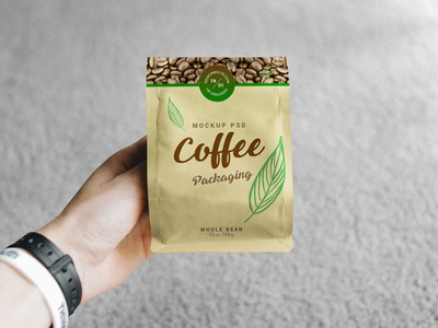 Free Hand Holding Coffee Packaging Mockup PSD