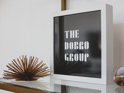 The Dobro Group Stationary & Swag stationery signage coffee mug sweatshirt notecards pens letterhead stickers business cards dobro design studio branding