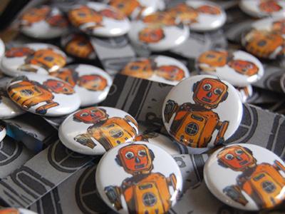 August 2012 Button Club buttonclub robot letterpress pinback buttons